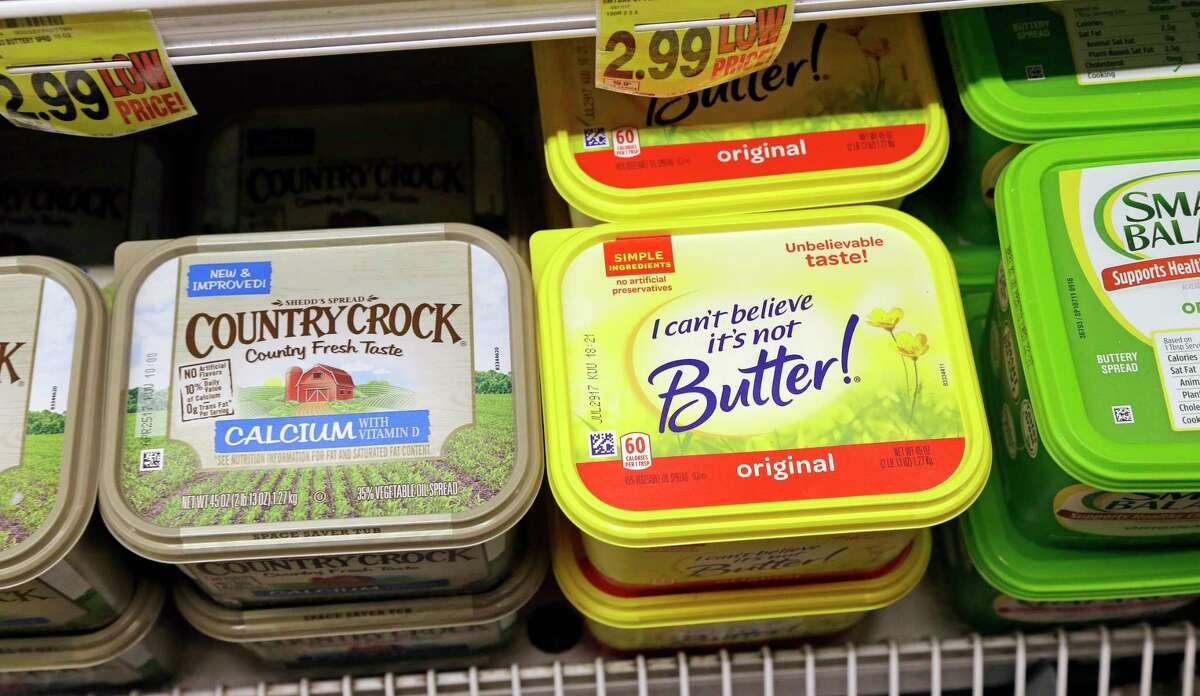 Containers of I Can't Believe It's Not Butter and Country Crock spreads appear on display in a grocery store cooler, Thursday, April 6, 2017, in Bellevue, Wash. Margarine's fortunes seem to be taking another sad turn, with the owner of the products looking for someone to take the brands off its hands. Consumer products heavyweight Unilever said it's seeking to unload its spreads business that has suffered from soft sales in the United States and other developed markets. (AP Photo/Elaine Thompson) ORG XMIT: WAET102