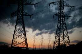 Power lines near the Lake Hubbard Power Plant in Dallas County, Texas, Feb. 27, 2012. Terrorists could black out large segments of the United States for weeks or months by attacking the power grid and damaging hard-to-replace components that are crucial  to making it work, the National Academies said in a report released Nov. 14. (Allison V. Smith/The New York Times)