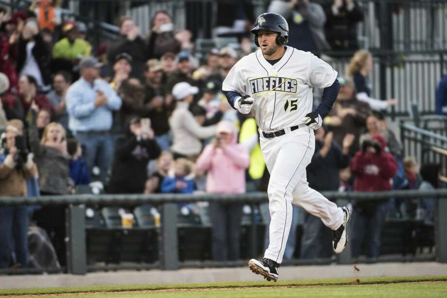Columbia Firefly's Tim Tebow approaches home plate after hitting a home run in his first at-bat, during the team's minor league baseball game against the Augusta GreenJackets on Thursday, April 6, 2017, in Columbia, S.C. (AP Photo/Sean Rayford) Photo: Sean Rayford/Associated Press