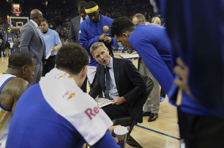 Whiteboard in hand, head coach Steve Kerr talks to the Warriors during a timeout at Oracle Arena last month. Photo: Michael Macor / Michael Macor / The Chronicle / ONLINE_YES