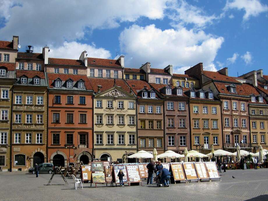 Colorful burghers' houses in the Old Town Market Square, Warsaw, were rebuilt using photos for reference. Photo: Yvonne Gordon, Special To The Chronicle