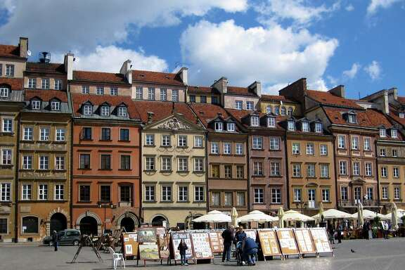 Colorful burgher's houses buildings in the Old Town Market Square, Warsaw, which were rebuilt using photos for reference.