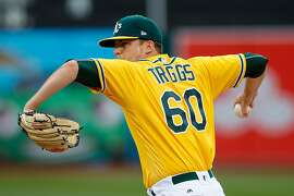 OAKLAND, CA - APRIL 06:  Andrew Triggs #60 of the Oakland Athletics pitches against the Los Angeles Angels of Anaheim during the first inning at the Oakland Coliseum on April 6, 2017 in Oakland, California. (Photo by Jason O. Watson/Getty Images)