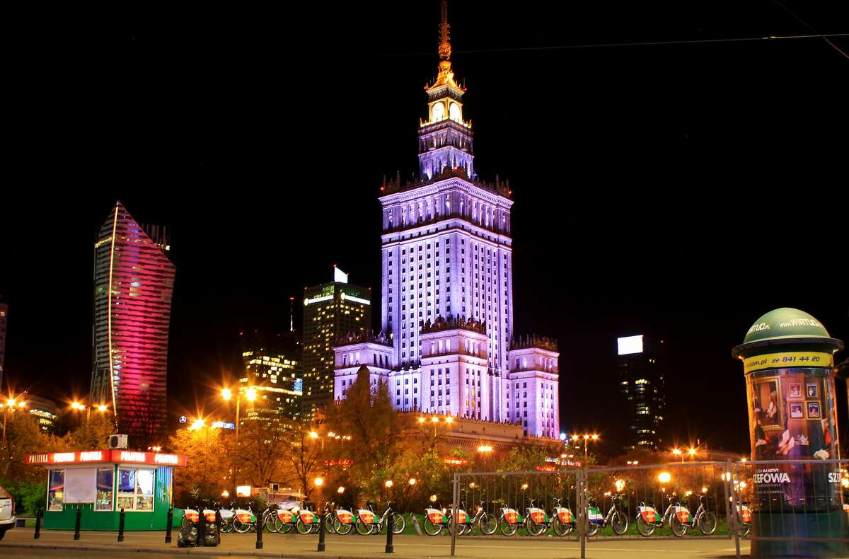 The Warsaw Skyline at night with Zlota 44 to the left and the Palace of Culture and Science.