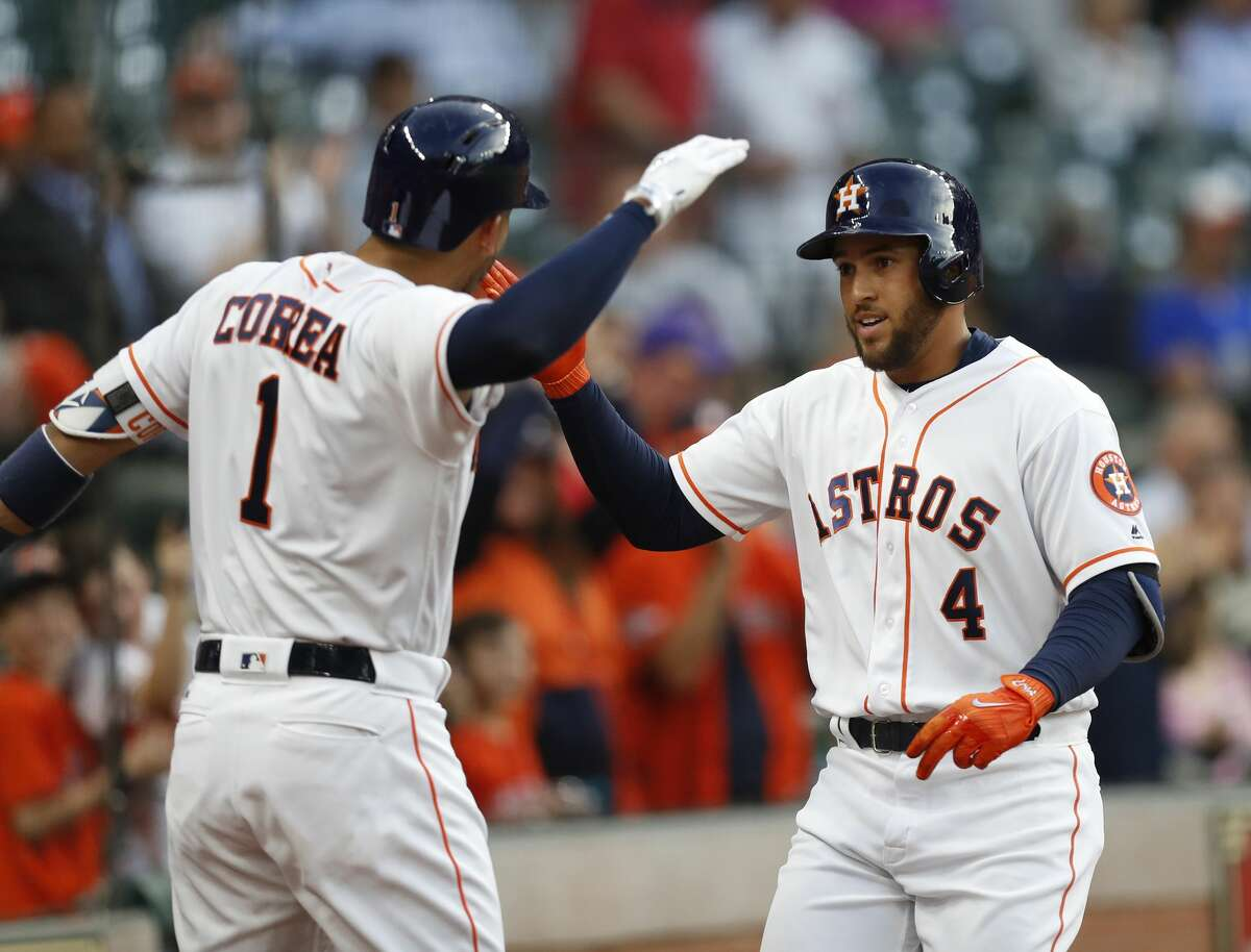Houston Astros right fielder George Springer (4) celebrates his home run with Carlos Correa (1) in the first inning of an MLB baseball game at Minute Maid Park, Thursday, April 6, 2017, in Houston. ( Karen Warren / Houston Chronicle )