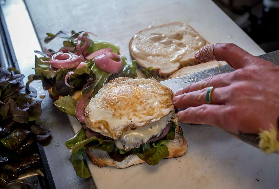 A burger topped with an egg at Dad's Luncheonette in Half Moon Bay. Photo: John Storey, Special To The Chronicle