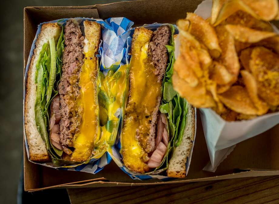 At Dad's Luncheonette in Half Moon Bay, the hamburger sandwich with homemade potato chips. Photo: John Storey, Special To The Chronicle