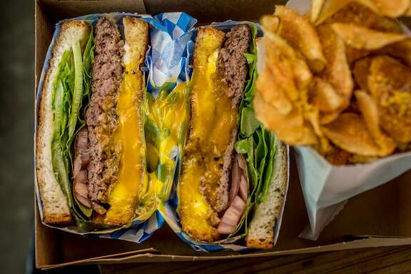 The Hamburger Sandwich with Homemade Potato Chips at Dad's Luncheonette in Half Moon Bay, Calif., are seen on April 6th, 2017.