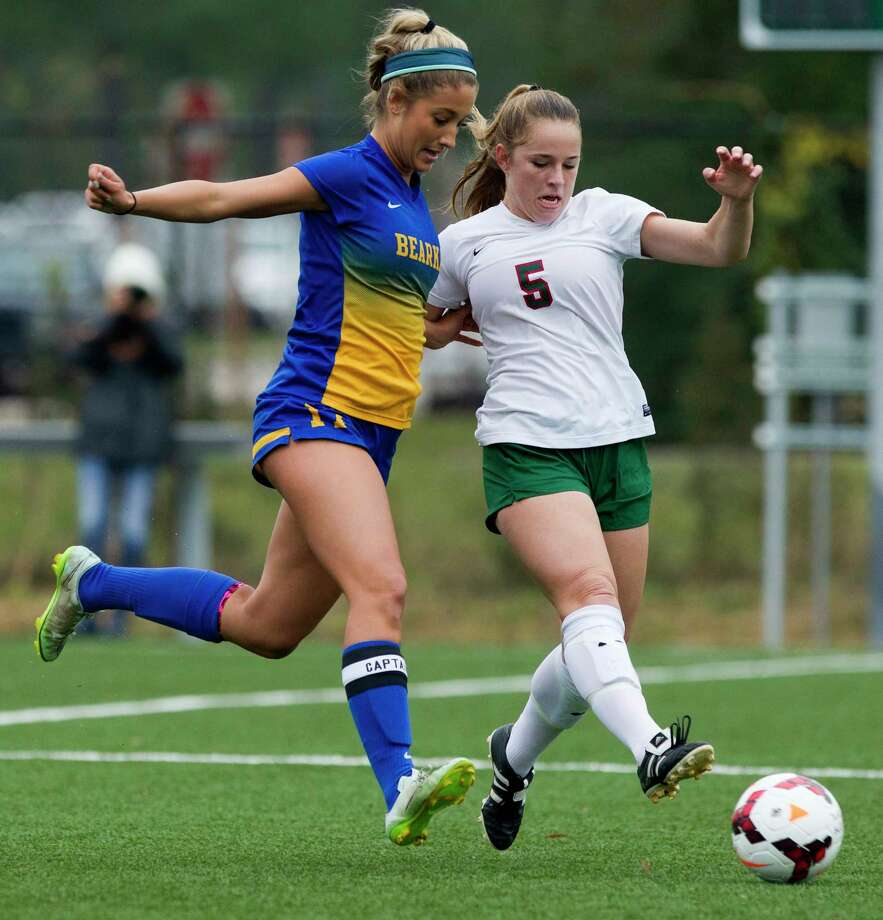 The Woodlands' Ana Helmert (5) battles for position against Klein's Riley Kaderli (17) during the first period of a girls high school soccer match at the Lady Highlander Invitational Thursday, Jan. 5, 2017, in The Woodlands. The Woodlands defeated Klein 4-2. Photo: Jason Fochtman, Staff Photographer / © 2017 Houston Chronicle