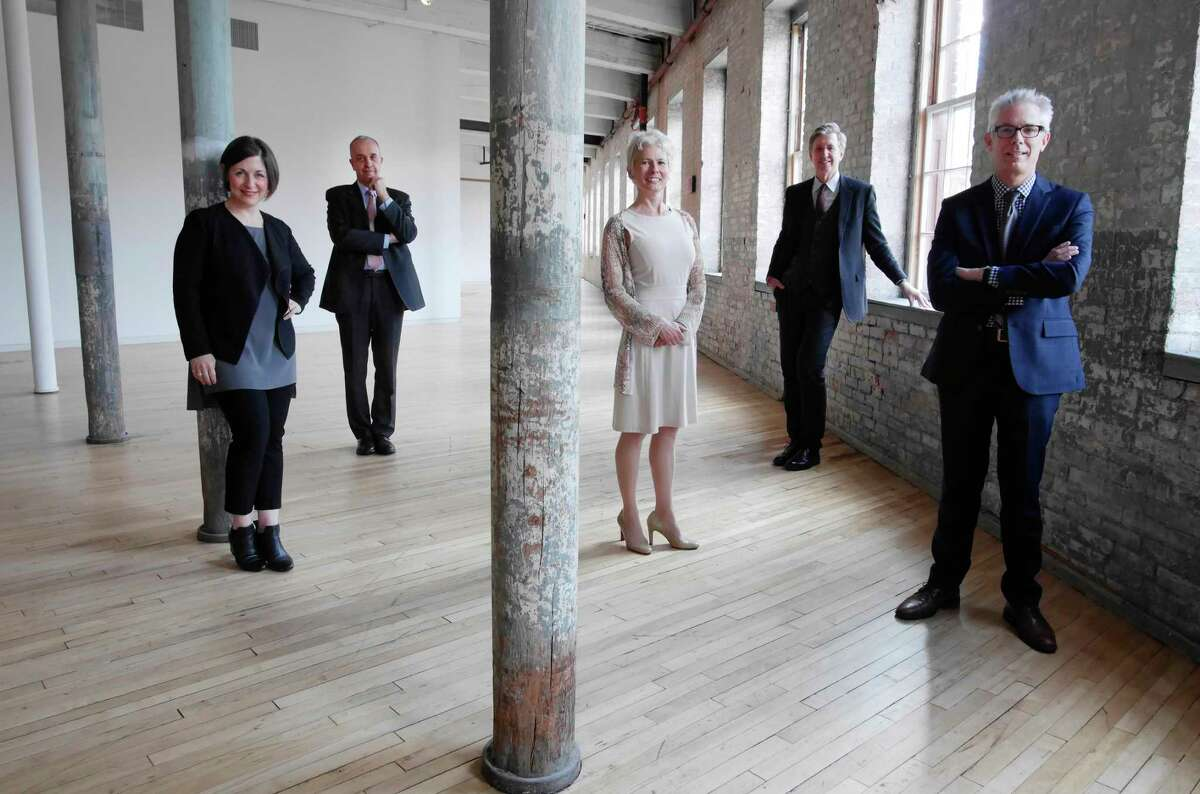 From left to right, Mandy Greenfield, artistic director Williamstown Theatre Festival, Olivier Meslay, director of The Clark Art Institute, Christina Olsen, director of the Williams College Museum of Art, Joe Thompson, director of Mass MoCA, and Robert Wolterstorff, director of the Bennington Museum, pose for a photo at Mass MoCA on Wednesday, April 5, 2017, in North Adams, MA. (Paul Buckowski / Times Union)