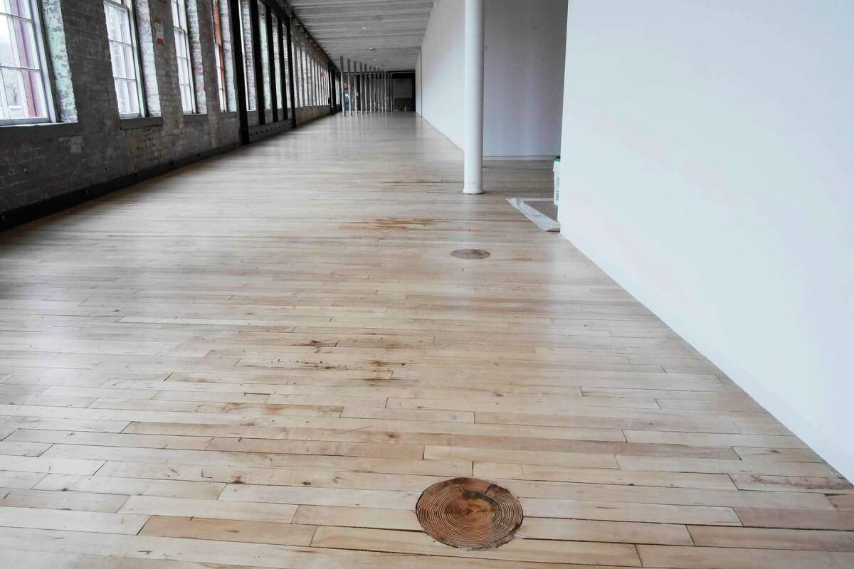 A view of gallery space in the newly renovated building 6 at Mass MOCA on Wednesday, April 5, 2017, in North Adams, MA. The circular mark on the floor is where a wooden post once rose up through the floor. Some posts were cut as walls were erected in the space. (Paul Buckowski / Times Union)