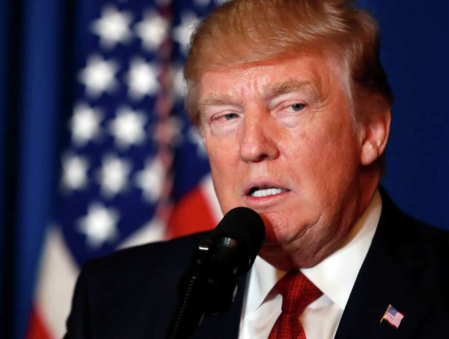 President Donald Trump speaks at Mar-a-Lago in Palm Beach, Fla., Thursday, April 6, 2017, after the U.S. fired a barrage of cruise missiles into Syria Thursday night in retaliation for this week's gruesome chemical weapons attack against civilians. (AP Photo/Alex Brandon) Photo: Alex Brandon, STF / Copyright 2017 The Associated Press. All rights reserved.