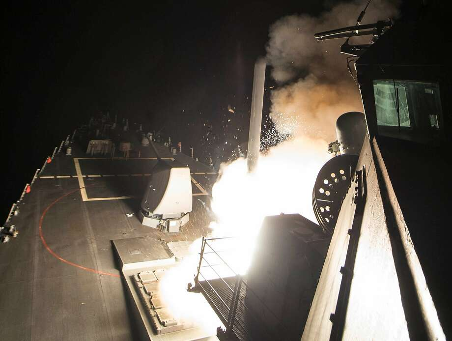 In an image provided by the US Navy, a Tomahawk cruise missile is launched from the USS Ross in a strike on a Syrian air base on April 7, 2017. President Donald Trump called the strike a response to the Syrian government's chemical weapons attack this week that killed more than 80 civilians.  Photo: ROBERT S. PRICE, US Navy