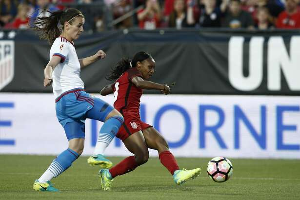 FRISCO, TX - APRIL 06:  Crystal Dunn #19 of the U.S. shoots and scores as Daria Makarenko #8 of Russia defends during the first half of the International Friendly soccer match at Toyota Stadium on April 6, 2017 in Frisco, Texas. (Photo by Mike Stone/Getty Images)