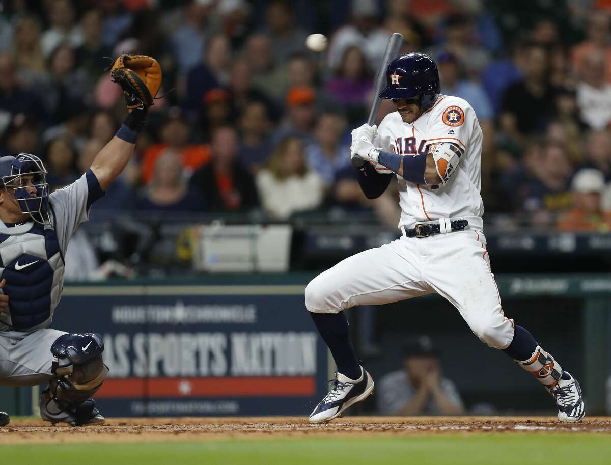 Houston Astros shortstop Carlos Correa (1) falls back from a pitch inside in the eighth inning of an MLB baseball game at Minute Maid Park, Thursday, April 6, 2017, in Houston. ( Karen Warren / Houston Chronicle )
