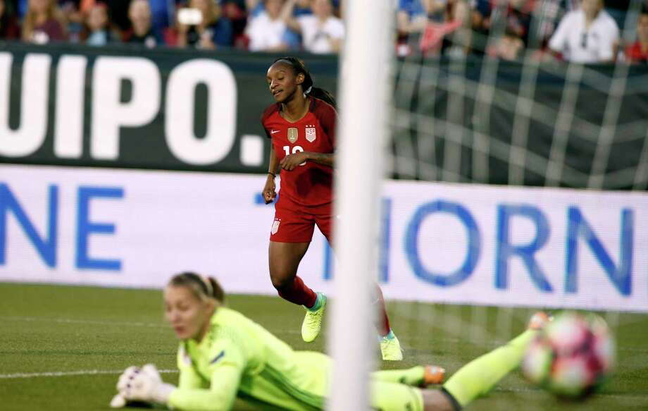 Crystal Dunn of the United States scores one of her two goals against Russian goaltender Alena Belyaeva in the first half of Thursday's match at Frisco. Photo: Mike Stone, Stringer / 2017 Getty Images