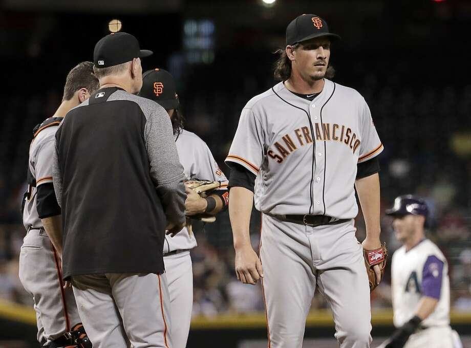 Manager Bruce Bochy removes Jeff Samardzija with one out in the sixth inning. Samardzija struck out nine but took the loss. Photo: Matt York, Associated Press