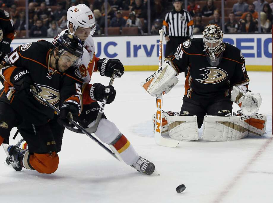 Anaheim Ducks center Antoine Vermette, left, vies for the puck with Calgary Flames right wing Alex Chiasson, center, on a deflection by Ducks goalie John Gibson, right, during the first period of an NHL hockey game in Anaheim, Calif., Tuesday, April 4, 2017. (AP Photo/Alex Gallardo) Photo: Alex Gallardo, Associated Press