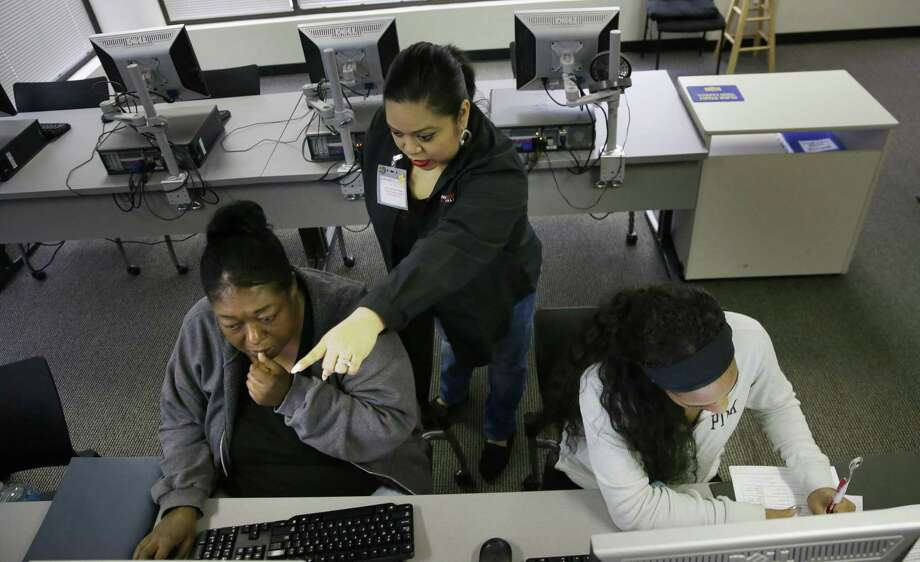 Job seekers Shonta Harris (left) and Kiana Cupit (right) participate in a résumé writing class with job search counselor Lorrie Cipriano-Wallace at the Texas Workforce Solutions office in Dallas. The private sector and the government added only 98,000 jobs in March, according to the Labor Department. Economists surveyed by Bloomberg had expected 175,000 jobs to be added in the month. Photo: LM Otero /Associated Press / Copyright 2017 The Associated Press. All rights reserved.
