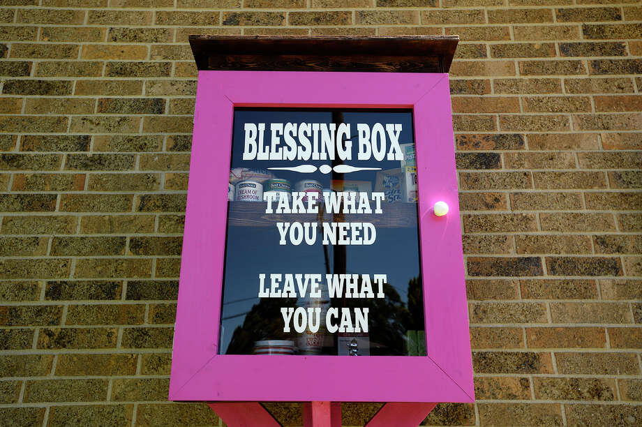 A blessing box outside of Debbie's Dance Studio in Groves is stocked with non-perishable foods and hygiene items for those in need. People are encouraged to take what they need or donate items to the box, made by Alicia Almaraz of Groves.Photo taken Thursday 4/6/17 Ryan Pelham/The Enterprise Photo: Ryan Pelham, Ryan Pelham/The Enterprise / ©2017 The Beaumont Enterprise/Ryan Pelham