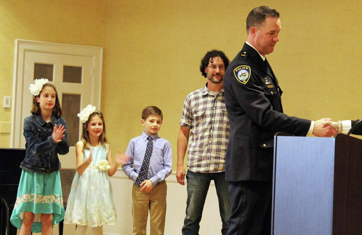 Darien police promote three and welcome three more officers