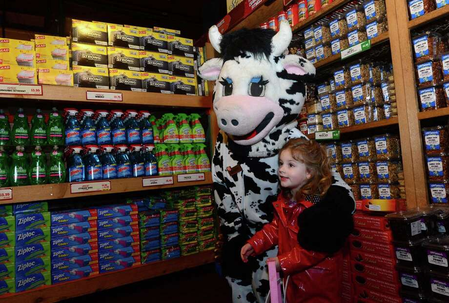 Vicki Stoddard, 3 of Darien, is greeted by the costumed character, Wow the Cow, during Stew Leonards Easter Egg Hunt Eggs-Travaganza April 4 in Norwalk. Children age 9 and under were be given a map of Stew Leonards and a bag to collect eggs from costumed characters throughout the store, including Wow the Cow, Cynthia Chick, and Daphne Duck among others. Each egg contained prizes ranging from candy and board games to toys and gift cards including the Egg Hunts top prize of $250 gift card to Toys R Us! Photo: Erik Trautmann / Hearst Connecticut Media / Norwalk Hour