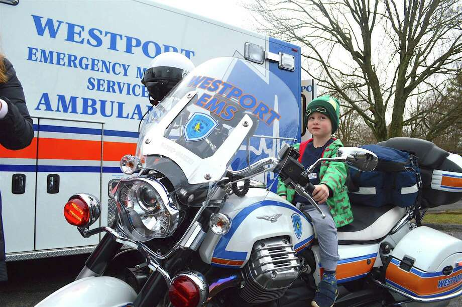 Harry Gibson, 3, of Fairfield, tries out the EMS motorcycle at the Touch-a-Truck event April 1 in Westport. Photo: Jarret Liotta / For Hearst Connecticut Media / Westport News Freelance