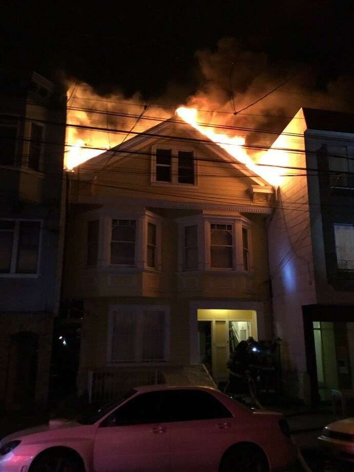 A heavy fire ripped through an apartment building in San Francisco's Richmond District, injuring three people, officials said.