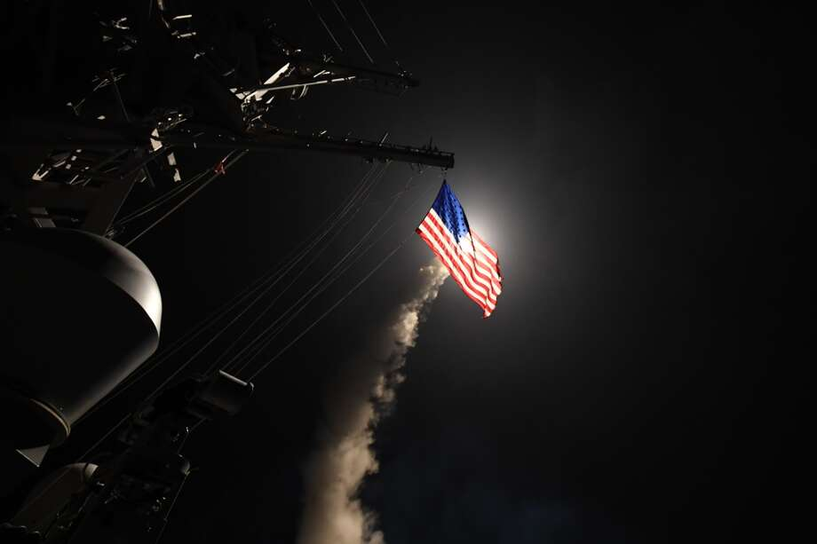MEDITERRANEAN SEA - APRIL 7:  In this handout provided by the U.S. Navy,The guided-missile destroyer USS Porter fires a Tomahawk land attack missile on April 7, 2017 in the Mediterranean Sea. The USS Porter was one of two destroyers that fired a total of 59 cruise missiles at a Syrian military airfield in retaliation for a chemical attack that killed scores of civilians this week. The attack was the first direct U.S. assault on Syria and the government of President Bashar al-Assad in the six-year war there.  (Photo by Ford Williams/U.S. Navy via Getty Images) Photo: Getty Images