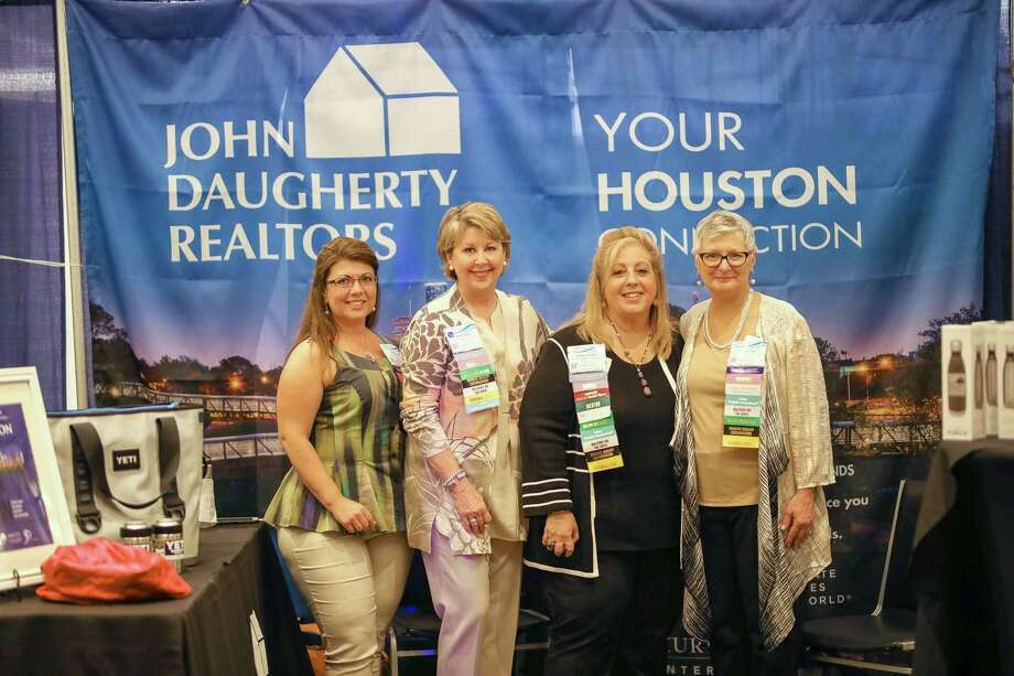 Shown at the John Daugherty, Realtors booth on Networking Night are Renee Eads, relocation manager; Cheri Fama, president; Anne Incorvia, executive vice president; and Becky Page, relocation manager.