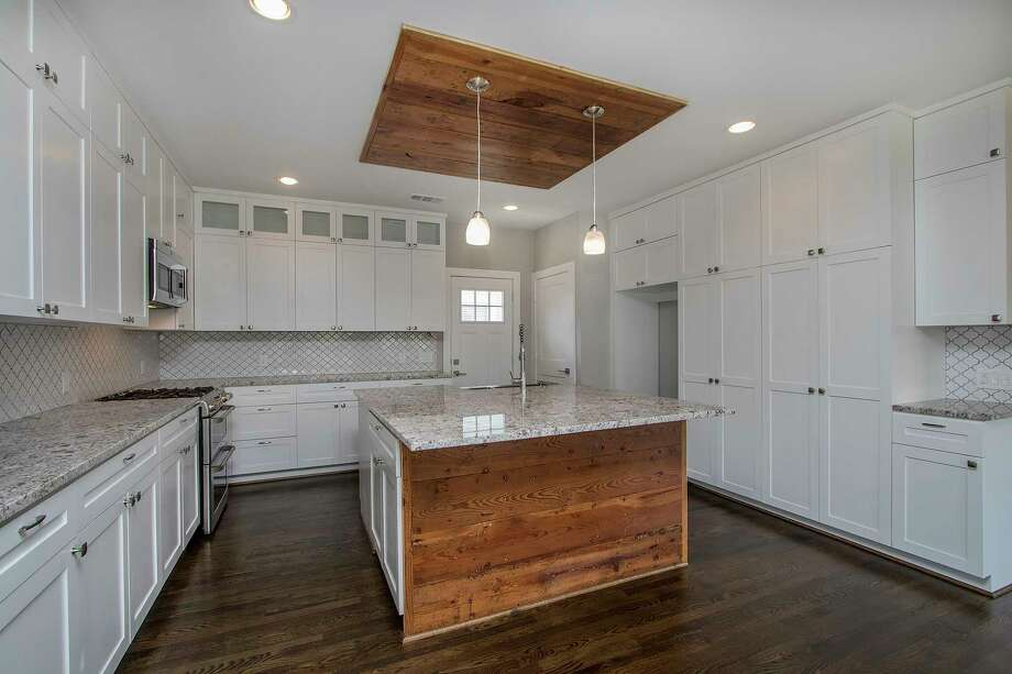 This kitchen in a remodeled home was built by Riverstone Builders. Photo: Courtesy Of Riverstone Builders