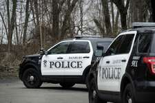 Police appear to have at least three suspects in custody after a car jacking at around 10 a.m. Friday, April 7, 2017.  in the Great Plains area of the city near the Danbury Town Park that forced two local schools into lockdown. The suspects drove to the end of Hawley Road Ext and fled on foot into the nearby woods. Police took the suspects into custody after a foot chase.