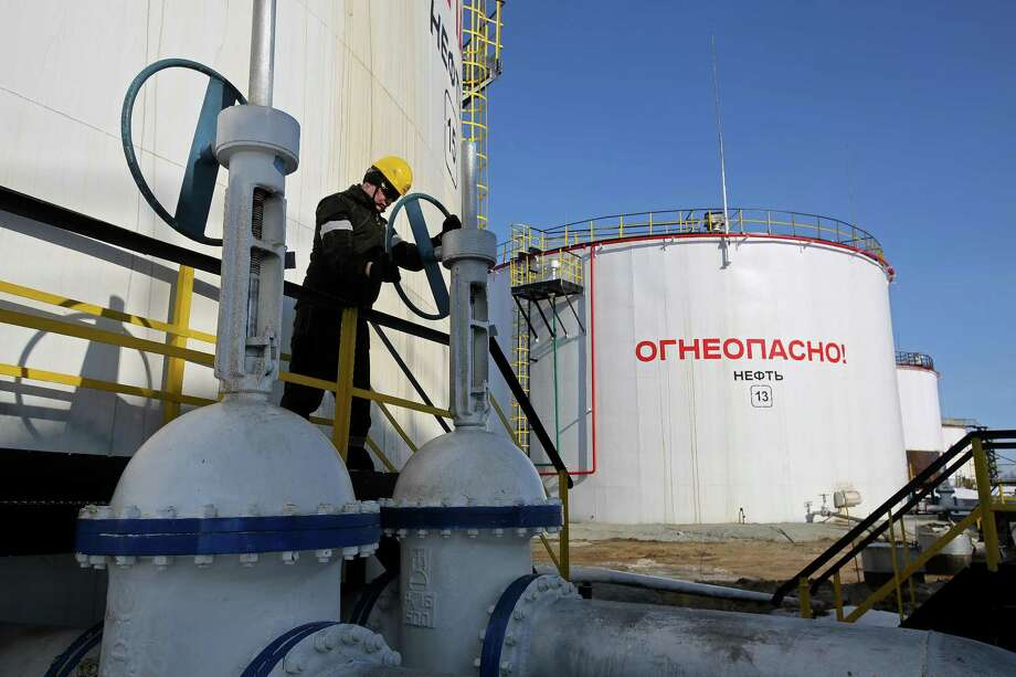A worker turns a flow valve near oil storage tanks at a pumping station in the Samotlor oil field near Nizhnevartovsk, Russia. Russia's deal with OPEC to cut crude supply hasn't delivered as much as expected, according to Deputy Prime Minister Arkady Dvorkovich. OPEC ministers will gather in Vienna on May 25 to decide whether to extend the accord. Photo: Andrey Rudakov /Bloomberg News / © 2017 Bloomberg Finance LP