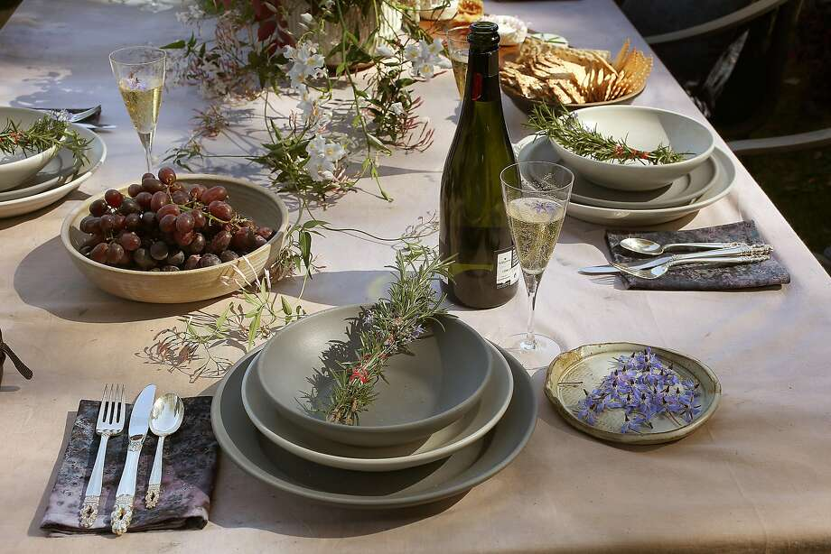 Hand-dyed tablecloth and napkins with Heath dinnerware and a rosemary smudge stick set an inviting table in Lafayette. Photo: Liz Hafalia, The Chronicle