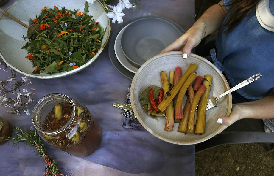 Kylie Flanagan passes the quick pickled rhubarb. Photo: Liz Hafalia, The Chronicle