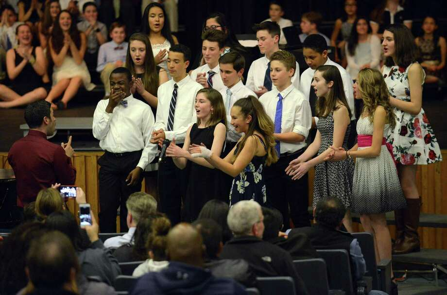 Members of the Rogers Acapella perform Ain't It Fun by Paramore during the Stamford Public Schools Choral Festival '17 at Cloonan Middle School in Stamford, Conn. on April 6, 2017. The annual event featured hundreds of high school students from AITE, Stamford and Westhill as well as middle school students from Cloonan, Dolan, Turn of River, Rippowam and Rogers International. Photo: Matthew Brown / Hearst Connecticut Media / Stamford Advocate