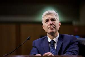 FILE-- Judge Neil Gorsuch, President Trump's nominee for the Supreme Court, while testifying on the third day of his confirmation hearing before the Senate Judiciary Committee on Capitol Hill, in Washington, March 22, 2017. Gorsuch was confirmed by the Senate on April 7 to become the 113th justice of the Supreme Court, capping a political brawl that lasted for more than a year and tested constitutional norms inside the Capitol's fraying upper chamber. (Eric Thayer/The New York Times)
