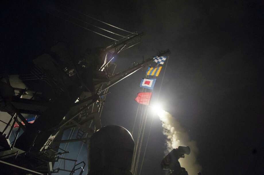 In an image provided by the US Navy, a Tomahawk cruise missile is launched from the USS Ross in a strike on a Syrian air base on April 7, 2017. President Donald Trump called the strike a response to the Syrian governmentÕs chemical weapons attack this week that killed more than 80 civilians. (Robert S. Price/US Navy via The New York Times) -- FOR EDITORIAL USE ONLY -- Photo: ROBERT S. PRICE, HO / NYT / US NAVY