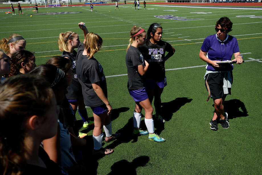 Port Neches-Groves coach Aimee Bates, right, talks with her players during practice on Thursday.  Photo taken Thursday 4/6/17 Ryan Pelham/The Enterprise Photo: Ryan Pelham / ©2017 The Beaumont Enterprise/Ryan Pelham