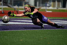 Port Neches-Groves goalkeeper Libbie Lejeune dives for a save during girls soccer practice on Thursday. The Lady Indians will play in the regional semifinals today.  Photo taken Thursday 4/6/17 Ryan Pelham/The Enterprise
