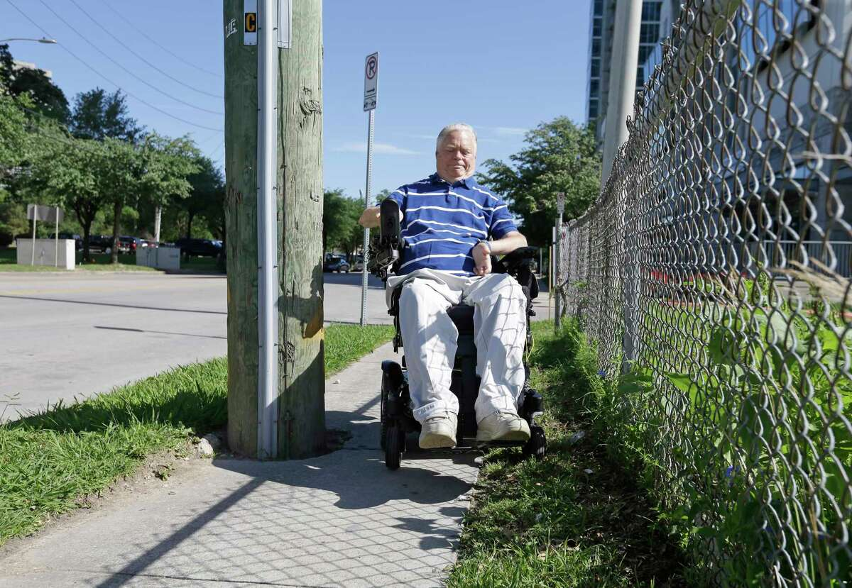 Dr. Lex Frieden, a Metro board member, is shown along Almeda near MacGregor where a utility pole blocks part of the sidewalk forcing him to move into the grass Tuesday, April 4, 2017, in Houston. He talked about the access to some bus stops being a challenge for the disabled. Over the years many bus stops have been blocked by utility poles or can't be accessed because of poor sidewalks and curbs. ( Melissa Phillip / Houston Chronicle )