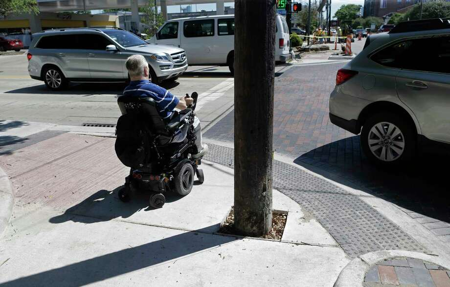 Dr. Lex Frieden, a Metro board member, is shown at the insection of Westheimer and Shepherd where a utility pole blocks part of the sidewalk Tuesday, April 4, 2017, in Houston. He talked about the access to some bus stops being a challenge for the disabled. Over the years many bus stops have been blocked by utility poles or can't be accessed because of poor sidewalks and curbs. ( Melissa Phillip / Houston Chronicle ) Photo: Melissa Phillip, Staff / © 2017 Houston Chronicle