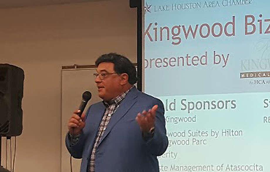 Andrew Schreer of Schreer Partnership announces new tenants for Shoppes at Kingsgate development during the Kingwood BizCom at Kingwood High School Thursday, April 6. Photo: Melanie Feuk