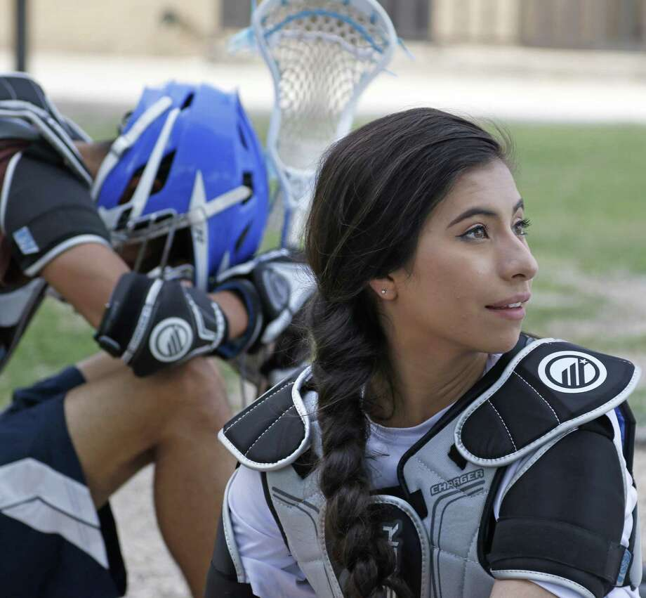 Amaya Marquez listens to conversation during water break at Lanier High School lacrosse practice on April 6, 2017 at J.T. Brackenridge Elementary School. Photo: Ron Cortes /For The Express-News / Freelance