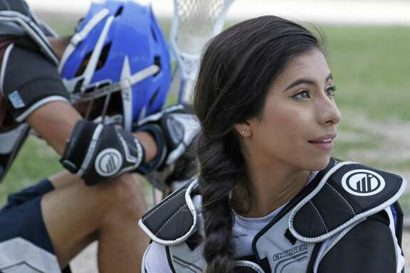Amaya Marquez listens to conversation during water break at Lanier High School lacrosse practice on April 6, 2017 at J.T. Brackenridge Elementary School.