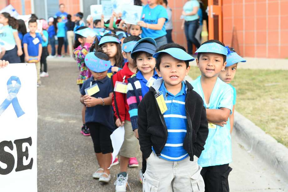 Students from Kawas Elementary marched down San Luis Street holding up signs to raise awareness for child abuse prevention on Friday, April 7, 2017. April is National Child Abuse Prevention Month. Photo: Danny Zaragoza/Laredo Morning Times