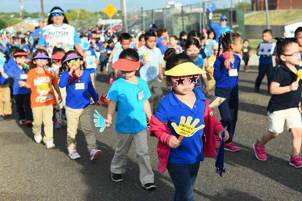 Students from Kawas Elementary marched down San Luis Street holding up signs to raise awareness for child abuse prevention on Friday, April 7, 2017. April is National Child Abuse Prevention Month.
