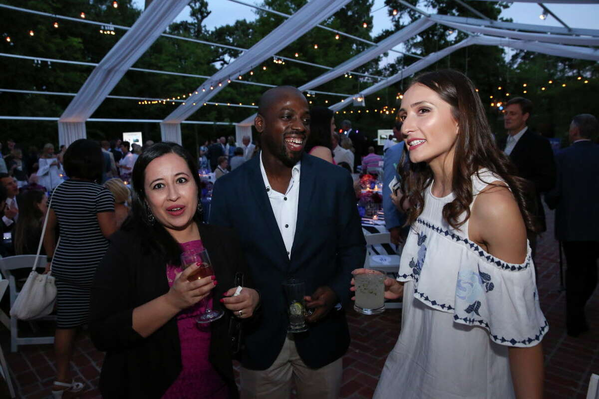 Araceli and Hakim Johnson, from left, and Carolina Velasquez have a conversation at Trees For Houston's 23rd Annual Root Ball at the Bayou Club Thursday, April 6, 2017, in Houston.