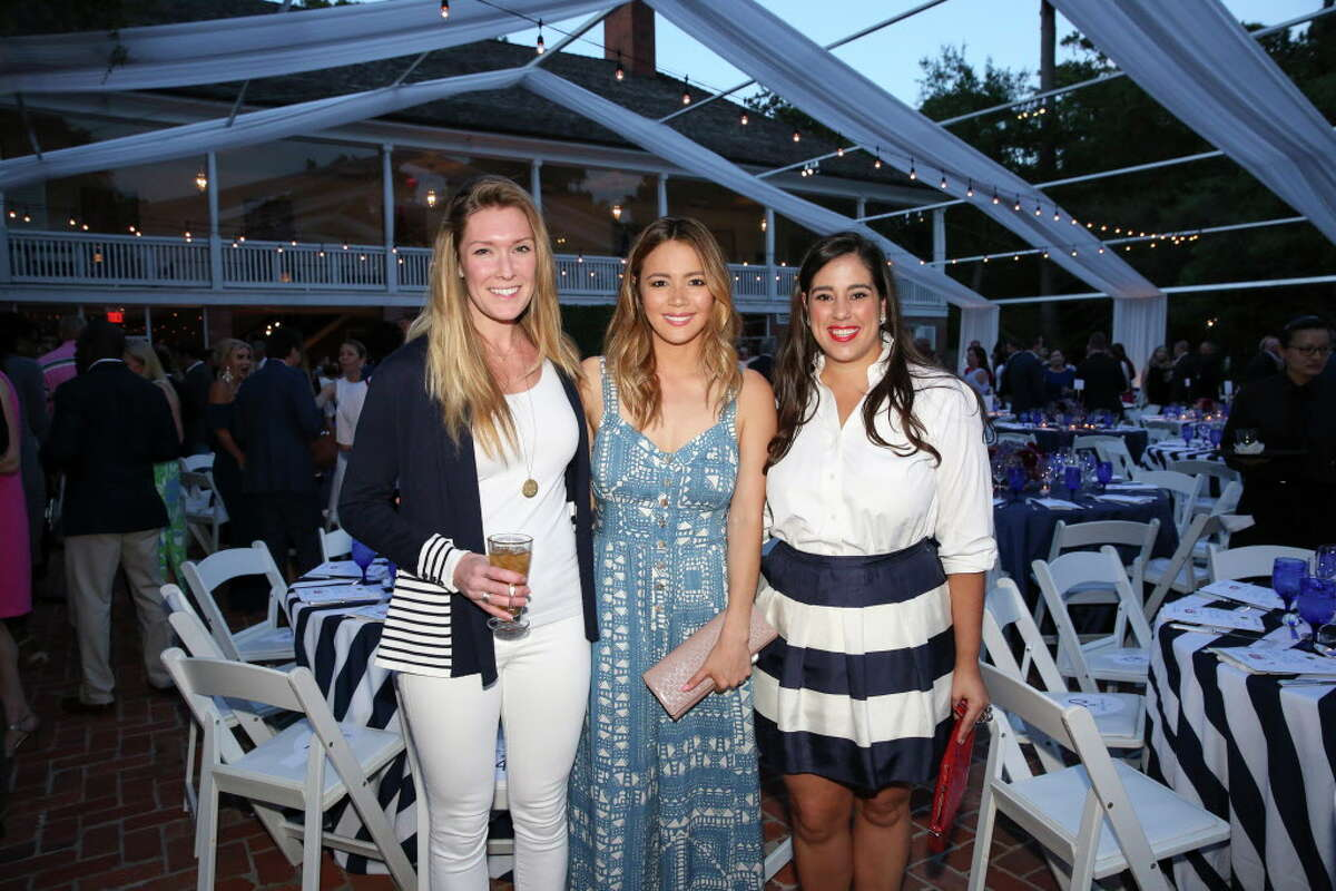 Alex Fincher, from left, Adrienne Sayward and Brett Ashley Longoria pose for a photo at Trees For Houston's 23rd Annual Root Ball at the Bayou Club Thursday, April 6, 2017, in Houston.