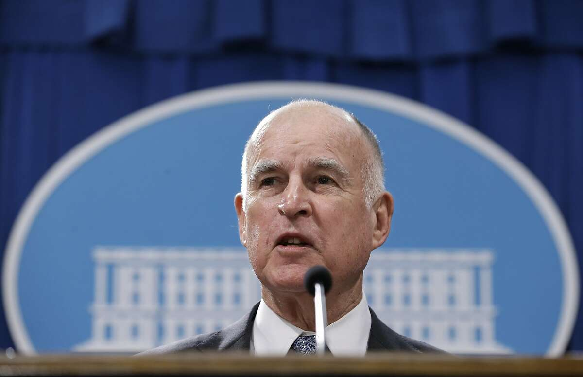FILE - In this Jan. 10, 2017, file photo, California Gov. Jerry Brown discusses his 2017-2018 state budget plan he released at a news conference in Sacramento, Calif. Gov. Jerry Brown likened President Donald Trump to a strongman whose goal of walling off the U.S.-Mexico border conjures other infamous barriers from the past. Brown said during an interview broadcast Sunday, March 26, 2017, on NBC's